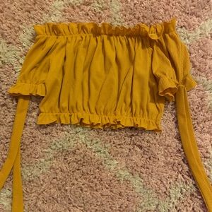 yellow shoulder top from pretty little thing.